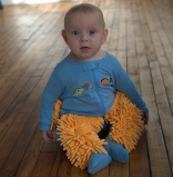 Babies can clean up after themselves with baby mop suit