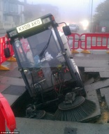 Street cleaner has lucky escape after pavement collapses