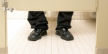 A quarter of men sit down on the toilet to use their mobile phones