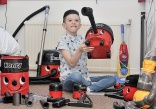 Boy addicted to vacuum cleaning