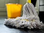 Man arrested for being aggressive in charge of a mop