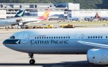 Cathay flight delayed after cleaner triggers emergency slide