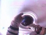 Russian cosmonauts clean space station windows