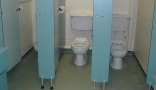UK budget cuts force school heads to clean toilets
