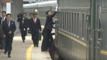Cleaners wipe down train before Kim Jong Un steps off