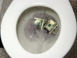Man flushes banknotes down the toilet